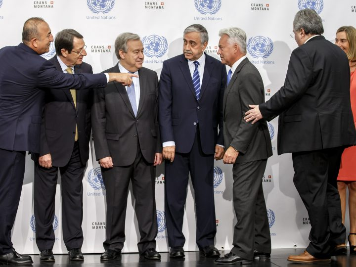 epa06069349 (L-R) Turkish Foreign Minister Mevlut Cavusoglu, Cypriot President Nicos Anastasiades, UN Secretary-General Antonio Guterres, Turkish Cypriot leader Mustafa Akinci, British European Affairs Minister Alan Duncan, Greek Foreign Minister Nikos Kotzias, and European Union Foreign Policy Chief Federica Mogherini, gesture before a group picture, prior beginning a meeting of the conference on Cyprus under the auspices of the United Nations, in Crans-Montana, Switzerland, 06 July 2017.  EPA/SALVATORE DI NOLFI