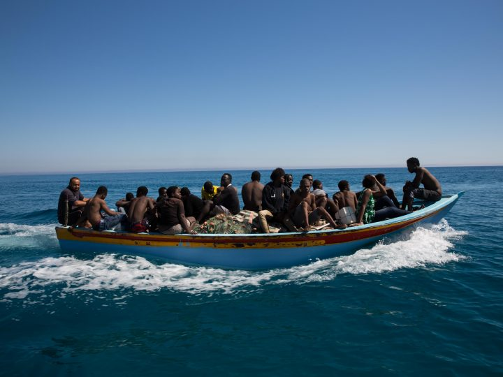 epaselect epa06076452 Migrants ride a boat after they were rescued by Libyan coastguard in the Mediterranean off the Libyan coast, in Guarabouli, east Tripoli, Libya, 08 July 2017. According to local reports, Libyan coastguards with the help of fishermen have rescued 85 immigrants, including 20 women, who were attempting to reach Europe. A rescued migrant have reported some 20 others went missing in the sea during their failed attempt.  EPA/STRINGER  EPA/STRINGER