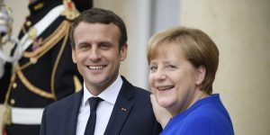 epa06085008 German Chancellor Angela Merkel (R) and French President Emmanuel Macron (L) after their meeting at the Elysee Palace in Paris, 13 July 2017.  EPA/JULIEN D ROSA