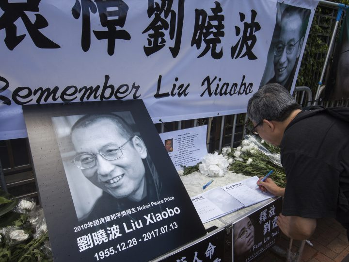 epa06086210 A member of the public signs a book of condolences as he pays respects to the late Chinese dissident and Nobel peace laureate Liu Xiaobo at a makeshift shrine outside the China Liaison Office in Western District, Hong Kong, China, 14 July 2017. Human rights and pro-democracy activists in Hong Kong are calling on the Chinese government to release Liu Xia, the widow of Liu Xiaobo. According to media reports on 13 July citing official sources, Liu Xiaobo has died aged 61.  EPA/ALEX HOFFORD