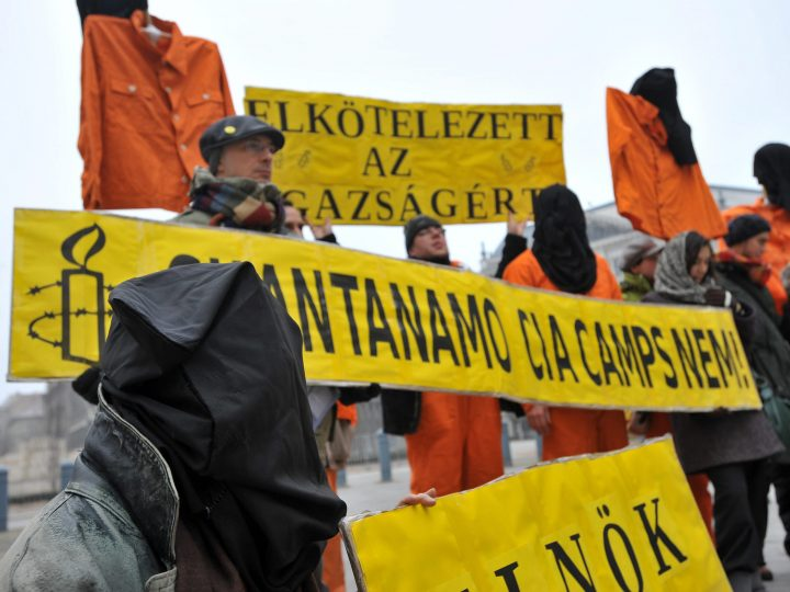 Amnesty International demonstrators dressed as Guantanamo prisoners protest against the US Guantanamo jail at the US base in Cuban territory outside the US embassy in Budapest, Hungary, 11 January 2009, on the seventh anniversary of the arrival of the first 20 prisoners for terrorism to Guantanamo. Their signs read in Hungarian 'Devoted for the truth' and 'No to Guantanamo CIA camps!'  EPA/TIBOR ILLYES HUNGARY OUT .