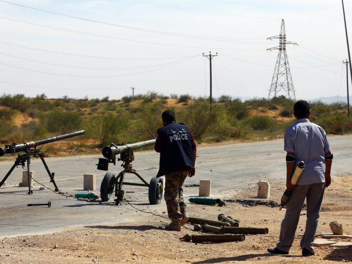 epa04670052 A Libyan militia mans a checkpoint with heavy weapons during clashes with rivals near Bir al-Ghanam, 90 km north of Tripoli, Libya, 19 march 2015. According to local reports one member of a militia blew himself up in clashes which claimed the lives of nine and left 14 wounded from both sides, as fighting continues in the war torn country, in which a senior commander from a group which has pledged allegiance to the group calling themselves the Islamic State (IS), Tunisian Ahmed Rouissi, was killed 17 March, and as the situation in Libya is expected to be discussed at an EU Heads of government meeting taking place in Brussels.  EPA/STR