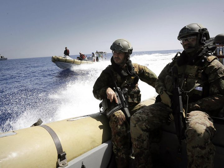 epa04966713 (FILE) A file picture dated 19 September 2015 shows members of the Italian Navy riding towards a boat spotted carrying migrants (not pictured) during a rescue operation in the Mediterran Sea. The European Union will launch on 07 October 2015, the first step of phase 2 of the European operation (EUNAVFOR Med) against migrant traffickers in the Mediterranean Sea. The Political and Security Committee, as a 'sign of hope', renamed the operation into 'Operation Sophia', after the name given to a baby born on a ship during an operation rescuing her mother on 22 August 2015, off the Libyan coast. The operation aims to block human smuggling and its trafficking networks, preventing further loss of life at sea. The deadliest migrants' journeys are those from Libya to Italy, with unaccounted lives lost during hazardous crossings at sea. Large masses of migrants from war-torn countries and conflict zones reached Europe in recent months, leading EU member states to deal with a migration influx crisis.  EPA/GIUSEPPE LAMI