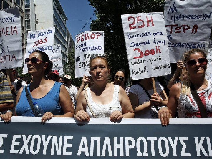 epa05407252 Protesters hold placards written in the Greek, German and English language  during a demonstration in front of the Greek Labour Ministry in Athens, Greece, 04 July 2016. The Greek Communist party unions in the fields of tourism, pensions, workers and students staged a protest against the social security law and unemployment.  EPA/SIMELA PANTZARTZI