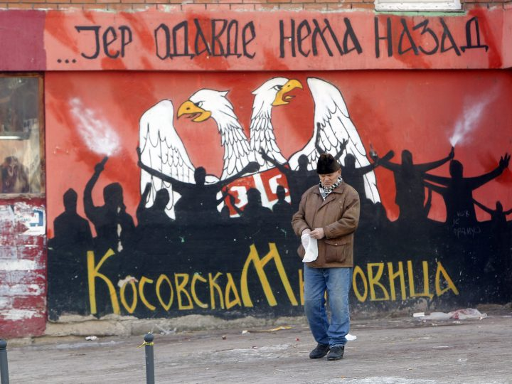 epa05718761 A Serbs resident of the northern part of Kosovska Mitrovica passes by a graffiti reading 'From here there is no way back' in the northern part of Kosovska Mitrovica, Kosovo, 15 January 2017. Several thousands of Serbs from Kosovo took part in the protest after a train travelling from Belgrade to Kosovska Mitrovica was prevented to enter into Kosovo by authorities. The train had 'Kosovo is Serbain' written in different languages on its coaches.  EPA/DJORDJE SAVIC
