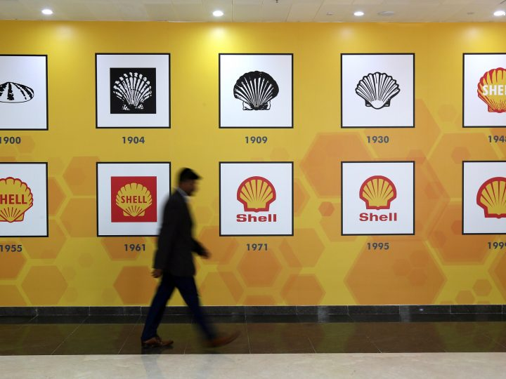 epa05881189 A man walks by in front of Shell cpmpany logosat an exhibition in the new Shell Technology Centre Bangalore (STCB) in Bangalore, India, 31 March 2017. Oil giant Royal Dutch Shell opened the new technology hub in Bangalore to expanding the company's Research and Developing activities in Asia. According to the company, it will create new opportunities for multidisciplinary collaboration, and drive relevant and affordable innovations for cleaner energy solutions for a growing world population. The 52-acre, custom built technology centre can house up to 1,500 experts working collaboratively on innovative projects worldwide, said Shell.  EPA/JAGADEESH NV