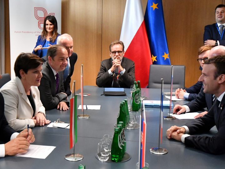 epa06044956 Prime Ministers of the 'Visegrad Group' countries: Hungary's Viktor Orban (L), Poland's Beata Szydlo (2-L) and Polish Deputy Minister of Foreign Affairs Konrad Szymanski (3L) meet with French President Emmanuel Macron (R), on the second day of the European Council in Brussels, Belgium, 23 June 2017. European heads of states and governments gather for a two-days European Council meeting on 22 and 23 June which will mainly 'focus on the ongoing efforts to strengthen the European Union and protect its citizens through the work on counterterrorism, security and defence, external borders, illegal migration and economic development'. On the meeting's second day the EU leaders 'are expected to reaffirm their commitment to a rules-based multilateral trading system, as well as to free trade and investment', the European Council said in a press release.  EPA/BARTLOMIEJ ZBOROWSKI POLAND OUT
