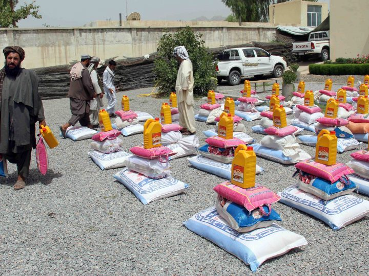 epa06125845 Afghan families who were displaced from Khakrez district of Kandahar due to ongoing conflicts between Taliban and Govt. security forces, receive food ration distributed by the authorities, in Kandahar, Afghanistan, 05 August 2017.  The government now controls less than 60 percent of Afghan territory amid gains for the Taliban, who governed the country for several years prior to the US invasion in October 2001.  EPA/MUHAMMAD SADIQ