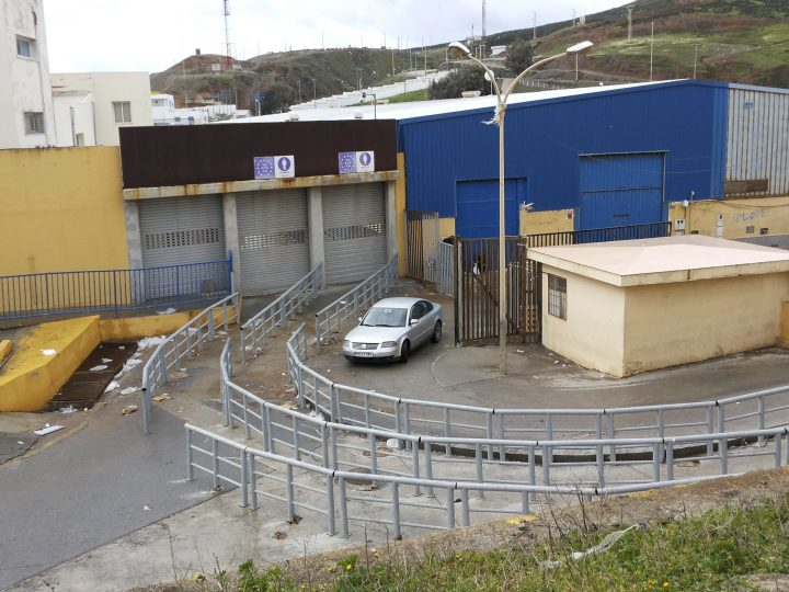 epa06137737 A general view of the Tarajal border crossing between Spain and Morocco, where some 250 migrants unsuccessfully attempted to jump the border, in Ceuta, Spanish enclave in northern Africa, 11 August 2017. Spanish authorities closed the border crossing on 09 August, after hundreds of migrants forced their way across the border enmass. The border is expected to be closed for one week.  EPA/REDUAN