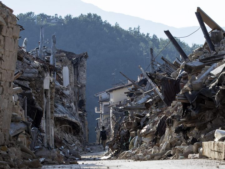 epaselect epa06158324 A man walks between the rubble in Amatrice,  Italy, on 01 August 2017. 24 August 2017 marks the first anniversary of the 6.1 magnitude earthquake that devastated parts of central Italy.  EPA-EFE/MASSIMO PERCOSSI ATTENTION: This Image is part of a PHOTO SET