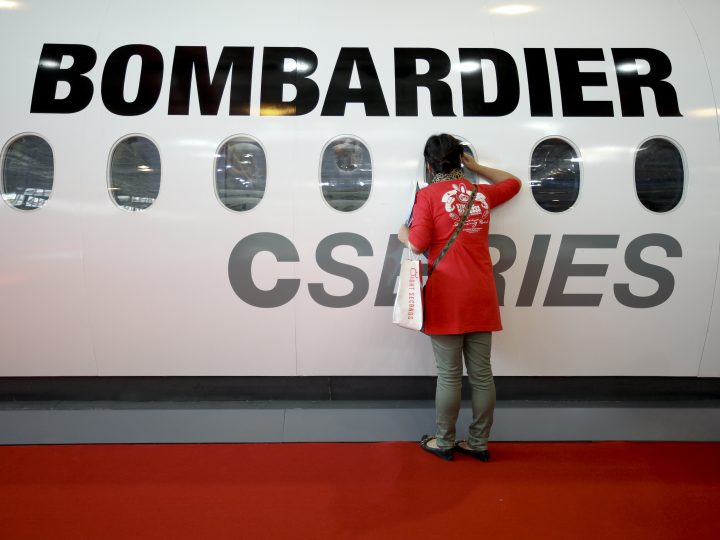 epa05595875 (FILE) A file photo dated 13 November 2012 showing a woman looking through a window of a model Bombardier C-Series airplane at the International Air Show in Zhuhai, China. The Canadian company announced 21 October 2016 that some 7,500 jobs may be lost as the company optimizes its workforce and conducts site specialization activities until 2018. Bombardier said they expect the measures to bring savings of some 300 million USD by the end of 2018.  EPA/DIEGO AZUBEL