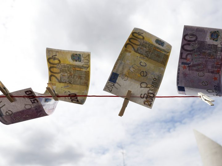 epa05925273 Fake Euro notes hang on a washing line during a protest action against money laundering in front of the Parliament offices in Berlin, Germany, 24 April 2017. Various associations call for an improvement in the law as they demonstrate before the finance committee debates on the implementation of the European guidelines on money laundery. According to them the German Federal law is lax on tax evasion and corruption.  EPA/FELIPE TRUEBA