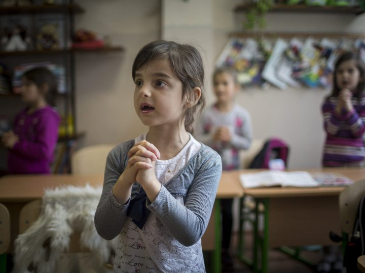 epa06051187 Children pray together after school hours in the classroom in Beregszasz, Transcarpathia, Ukraine, 04 May 2017. (issued 26 June) Beregszasz and its closest vicinity ? the villages of Asztely, Beregardo, Bulcsu, Deda, Kigyos, Macsola and Makkosjanosi ? belong to the Diocese of the Transcarpathian Reformed Church. Across the almost exclusively Hungarian inhabited territory approximately 350-400 children live at or below the minimum of subsistance. An average salary equals to 115 while an average pension to 40 Euros in the region, but the price of food, rent and that of the fuel, however, comes near to whatever it costs in Hungary. The economic crisis that followed the armed conflict in East-Ukraine has resulted in unforseen and unwanted everyday challenges all over the country and for people living close to the Hungarian border. Deprived children lack not only toys and summer camps but often have to go without essential foodstuff, warm clothing or bathing facilities and equipment.  Transcarpathian children are supported by Hungarian churches and the Hungarian state with various programs and donations, like catering, housing and holiday programs. Church congregations, schools, orphanages, foster homes and hospitals of Transcarpathia are also regularly aided by shipments of food, clothing and money from Hungary. The Ministry of Foreign Affairs and Trade and the Hungarian Reformed Charity Service have launched charity collections to help Transcarpathian children.  EPA/Balazs Mohai HUNGARY OUT ATTENTION: This Image is part of a PHOTO SET