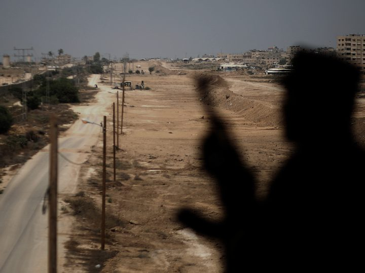 epa06209627 (FILE) - A Hamas security guards is silhouetted while standing guard near the border between Egypt and Gaza Strip in Rafah, southern Gaza Strip, 17 August 2017 (reissued 17 September 2017). Palestinian Islamist Hamas group said on 17 September 2017 it has dissolved its administration that runs Gaza and agrees to hold general elections in order to end a long-running feud with President Mahmoud Abbas?s Fatah movement.  EPA-EFE/HASSAN ALI