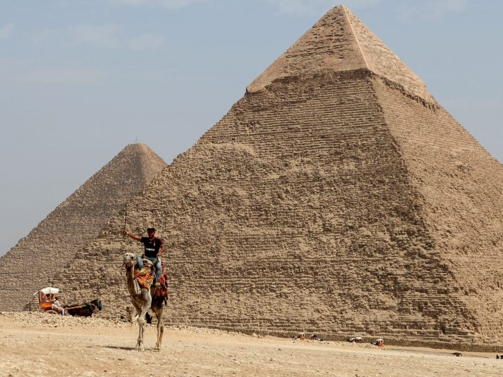epa06303912 (FILE) - A man rides his camel in front of the pyramid of Khufu, or Cheops, in Giza, Egypt, 29 March 2017 (reissued 02 November 2017). A team of French and Japanese researchers began in October 2015 the Scan Pyramids Mission project to scan the Great Pyramid of Khufu and announced on 02 November 2017 that analyses showed a 'big void' in the Pyramid by observation of cosmic-ray muons, that are only partially absorbed by stone, an empty space of at least 30 meters long that could be a possible hidden chamber.  EPA-EFE/MOHAMED HOSSAM