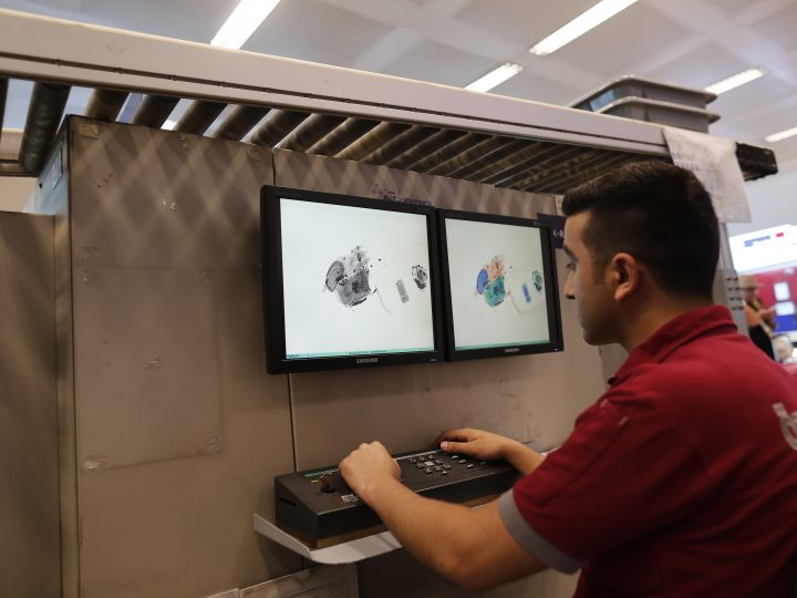 epa05397156 A security officer checks suitcases under an X-Ray scanner in the aftermath of multiple suicide bomb attacks at Ataturk international airport in Istanbul, Turkey, 29 June 2016. At least 36 people were killed and more than 140 others were wounded in three separate gun and bomb attack outside and inside the terminal of Istanbul's Ataturk international airport on 28 June, media reported quoting officials. The attacks have been linked to either the so-called Islamic State (IS or ISIS) militant group or Kurdish separatists, media added.  EPA/SEDAT SUNA
