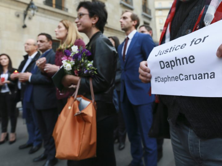 epa06273950 European journalists joined by EU commissioner during a silent vigil in memory of Maltese journalist Daphne  Caruana Galizia in Brussels Belgium, 18 October 2017. Daphne Caruana Galizia, 53, was killed in a car bombing near Mosta , Malta on 16 October . She was known for her blog accusing top politicians of corruption.  EPA-EFE/OLIVIER HOSLET