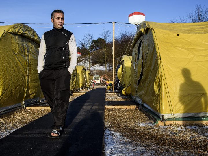 epa05126781 (FILE) A file photo dated 22 January 2016 showing Mohamad Salai, a refugee, walking through the refugee tent camp in Naestved, some 60 km south of Copenhagen. Danish lawmakers were 26 January 2016 set to vote on measures to tighten asylum laws, including a controversial plan to seize assets from asylum seekers to pay for their stay, despite criticism from human rights groups. The bill was expected to pass as the right-leaning Liberals' minority government has secured backing from others, including the main opposition Social Democrats and the anti-immigrant Danish People's Party. The move would allow for asylum seekers' belongings to be searched and for cash or valuables exceeding 10,000 kroner (1,450 dollars) to be seized. The cash and proceeds from the sale of the valuables - such as watches and mobile phones - would be used to pay for the asylum seekers' stay in Denmark.  EPA/NIELS AHLMANN OLESEN DENMARK OUT