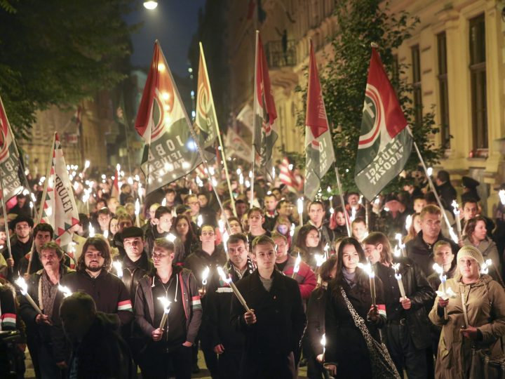 epa05599836 Supporters of the oppositional right-wing Jobbik party of Hungary march with candles during commemorative events to mark the 60th anniversary of the outbreak of the 1956 Hungarian revolution and freedom fight against communism and Soviet rule in downtown Budapest, Hungary, 23 October 2016.  EPA/Balazs Mohai HUNGARY OUT