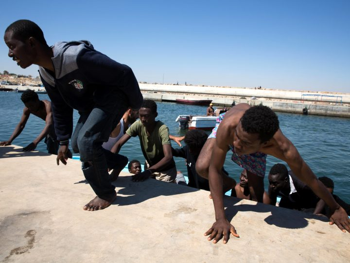 epa06076441 Migrants disembark a boat after they were rescued by Libyan coastguard in the Mediterranean off the Libyan coast, in Guarabouli, east Tripoli, Libya, 08 July 2017. According to local reports, Libyan coastguards with the help of fishermen have rescued 85 immigrants, including 20 women, who were attempting to reach Europe. A rescued migrant have reported some 20 others went missing in the sea during their failed attempt.  EPA/STRINGER
