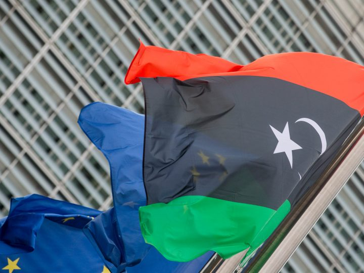 epa05766026 The Libyan flag floats next to the European flag at EU Commission in Brussels, Belgium, 02 February 2017. Prime Minister of Libya Fayez al-Sarraj is to meet with European Council President Donald Tusk on 02 February.  EPA/STEPHANIE LECOCQ