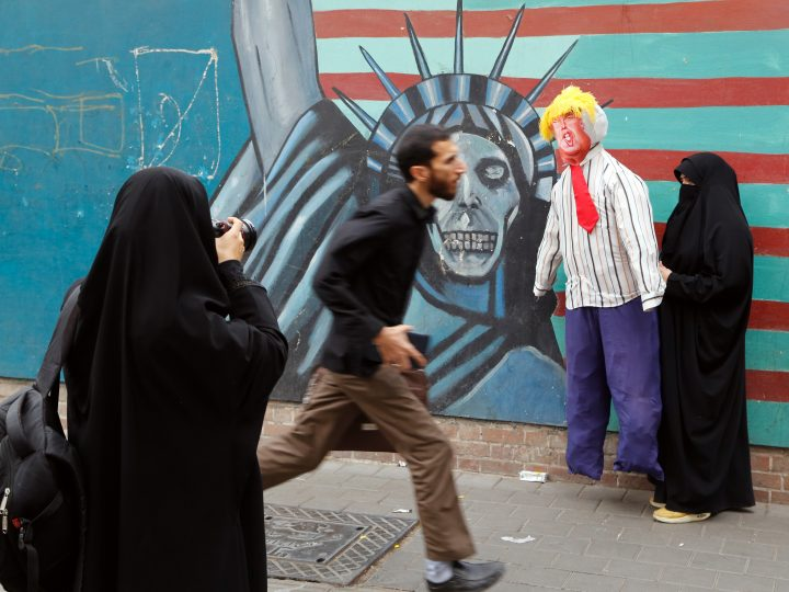 epa06307386 An Iranian woman holds an effigy of US President Donald J. Trump in front of an anti-US mural during an anti-US demonstration marking the 38th anniversary of US Embassy takeover, in front of the former US embassy in Tehran, Iran, 04 November 2017. Media reported that Thousands of protesters chanting 'Death to America' gathered at the former US embassy in Tehran to mark the 38th anniversary of the start of the Iran hostage crisis. Iranian students occupied the embassy on November 04, 1979 after the USA granted permission to the late Iranian Shah to be hospitalised in the States. Over 50 US diplomats and guards were held hostage by students for 444 days.  EPA-EFE/ABEDIN TAHERKENAREH