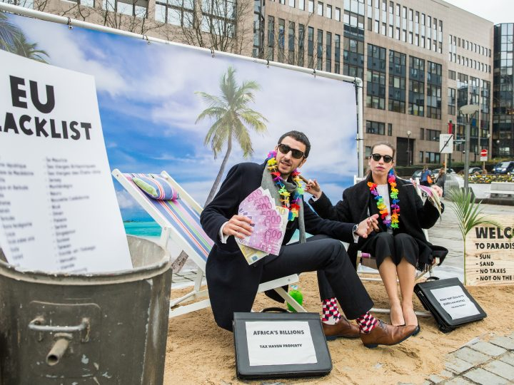 epa06368440 Two actors pose in a scenery of a 'Tax Haven' during an action of the international confederation of charitable organizations 'Oxfam' to demand European politicians to adopt a black list of tax havens in front of the European Council in Brussels, Belgium, 05 December 2017. European finance ministers were meeting the same day and were expected to adopt an EU blacklist of tax havens.  EPA-EFE/STEPHANIE LECOCQ