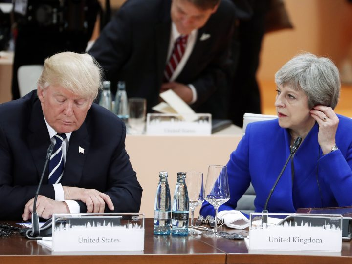 epa06432769 (FILE) - US President Donald J. Trump (L) and British Prime Minister Theresa May (R) during a plenary session of the G20 summit in Hamburg, Germany, 07 July 2017 (reissued 12 January 2018). Media reports on 12 January 2018 state that US President Donald J. Trump has cancelled a visit to Britain planned for February 2018, saying he was not a 'big fan' of the new US embassy one billion US dollar building in London which he was due to open in February 2018.  EPA-EFE/FELIPE TRUEBA