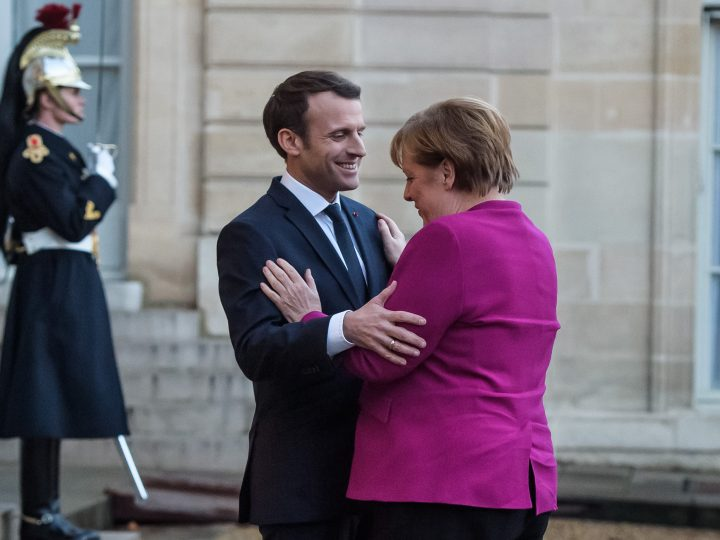 epa06454547 French President Emmanuel Macron (L) welcomes German Chancellor Angela Merkel (R) prior to their meeting at Elysee Palace in Paris, France, 19 January 2018. Merkel is in Paris for a one-day working visit.  EPA-EFE/CHRISTOPHE PETIT TESSON
