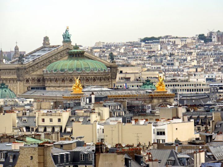 Golden Statues are on the rooftop of the Paris Opera House building, seen from the Wheel of Paris.