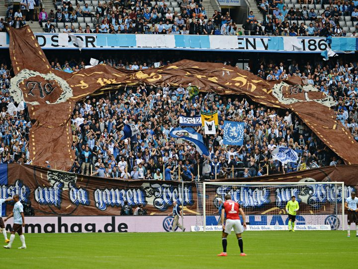 epa04408821 Fans unroll a giant lederhosen during the German Bundesliga second division soccer match between TSV†1860 Munich and FC Ingolstadt 04 at Allianz Arena in†Munich,†Germany, 20 September 2014. Munich is wearing a special jersey for the Oktoberfest.  (ATTENTION: Due to the accreditation guidelines, the DFL only permits the publication and utilisation of up to 15 pictures per match on the internet and in online media during the match.)  EPA/NICOLAS†ARMER