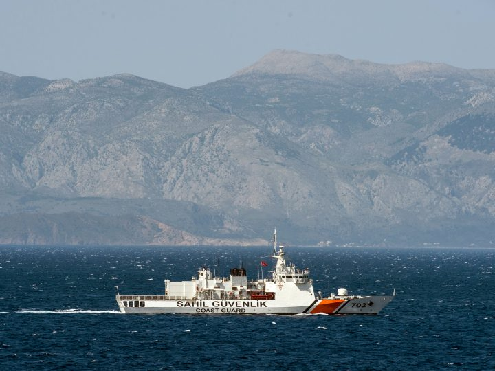 epa05268753 A Turkish coast guard ship patrols on the Aegean Sea, off the Turkish coast 20 April 2016. The German navy support ship Bonn, in the Aegean Sea as part of a NATO naval presence in the Aegean meant to observe and monitor illegal movement between Turkey and Greece.  EPA/JOHN MACDOUGALL / POOL