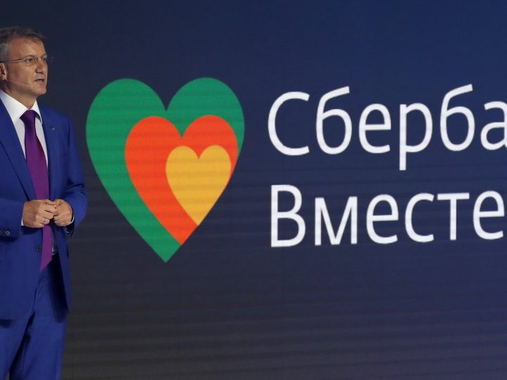 epa05990927 Sberbank chief executive Herman Gref delivers a speech near a slogan reading as 'Sberbank together' during the Annual General Shareholders' Meeting of Sberbank in Moscow, Russia, 26 May 2017. The net profit of Sberbank of Russia in 2016 grew by 2.4 times compared to the previous year and amounted to 8.52 billion euros (542 billion rubles), the annual report of the Russian bank under IFRS. Sberbank is the key lender to the Russian economy and the biggest receiver of deposits in Russia? Sberbank ranked 56 in the annual Forbes' Global 2000 list, up 46 ranks from last year. Among Russian companies, Sberbank went up from third to second place in the ranking.  EPA/SERGEI ILNITSKY