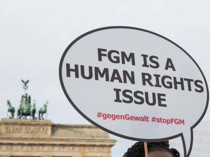 epa06345309 A participant of the rally against female genital mutilation holds a placard at the Brandenburg Gate in Berlin, Germany, 23 November 2017. A group of activists 'TERRE DES FEMMES' organized the event ahead of the International Day for the Elimination of Violence against Women on 25 November which was designated by the United Nations.  EPA-EFE/H. JEON