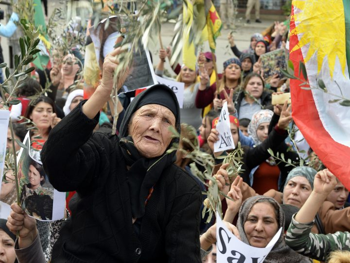 epa06498130 Kurdish protesters carry national flags, olive branches, and placards as they shout slogans during a protest against what they call the 'Turkish aggression' in northern Syria, near the US embassy in Awkar, east of Beirut, Lebanon, 05 February 2018. The Turkish army is on an operation named 'Operation Olive Branch' in Syria's northern regions against the Kurdish Popular Protection Units (YPG) forces which control the city of Afrin. Turkey classifies the YPG as a terrorist organization.  EPA-EFE/WAEL HAMZEH