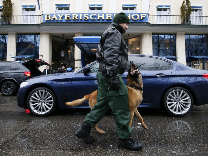 epa06531647 A police sniffer dog for explosive materials and its handler check the perimeter around the 'Bayerischer Hof' hotel, the venue of the 54th Munich Security Conference (MSC), in Munich, Germany, 16 February 2018. In the annual meeting, international politicians, various experts and guests from around the world discuss issues of the global security from 16 to 18 February.  EPA-EFE/RONALD WITTEK