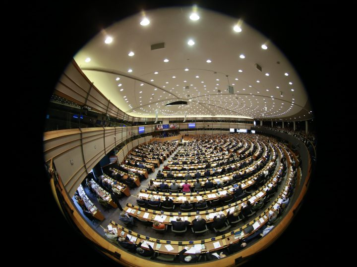 epa06572265 A fish eye lens view of members of the European Parliament vote for the proposition of European Commission Vice President, Dutch, Frans Timmermans to activate Article 7 (1) TEU regarding the situation in Poland during a plenary session of the European parliament in Brussels, Belgium 01 March 2018. Article 7 (1) TEU regarding the situation in Poland, inlcuding the rule of law, spearation of powers, fundamental rights and independence of judiciary. Article 7 of the Treaty on European Union is a procedure in the treaties of the European Union (EU) to suspend certain rights from a member state.  EPA-EFE/OLIVIER HOSLET