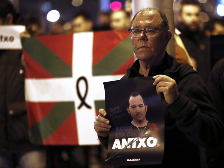 epa06587914 A man holds a picture of Spanish late prisoner Xabier Rey who was found dead on 06 March after allegedly committing suicide at the Puerto III penitentiary center in Cadiz, during a protest in his honor in Pamplona, Navarra, northern Spain, 07 March 2018. Rey was sentenced to 26 years on 2008 for being involved in Basque terrorist group ETA.  EPA-EFE/JDIGES