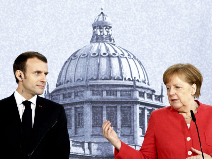 epa06679422 German Chancellor Angela Merkel (R) and French President Emmanuel Macron (L) hold a press conference following a visit at the Humboldt Forum construction site in Berlin, Germany, 19 April 2018. The two leaders are meeting following Macron's delivery of an impassioned speech at the European Parliament on 17 April, in which he urged reforms to further bind EU member states together and to counter authoritarianism. The Humboldt Forum, to be located in the reconstructed Berlin City Palace, in German called the Berliner Schloss, will draw on the collections of other Berlin museums and is to become the world's pre-eminent museum dedicated to non-Western art.  EPA-EFE/CARSTEN KOALL / POOL