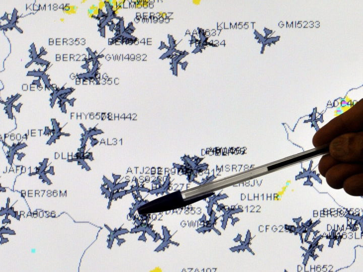 epa02125140 A member of the crisis committee of the German air traffic control shows a map with the flight movements over Germany in Langen, Germany, 20 April 2010. The committee decides about the ban on flying in the German air space and about visual flight rules flights after the volcanic eruption on Iceland. The air traffic control confers with experts of the German Transport Ministry, the German Weather Service, the Federal supervision department for flight security and Eurocontrol.  EPA/MARIUS BECKER / POOL