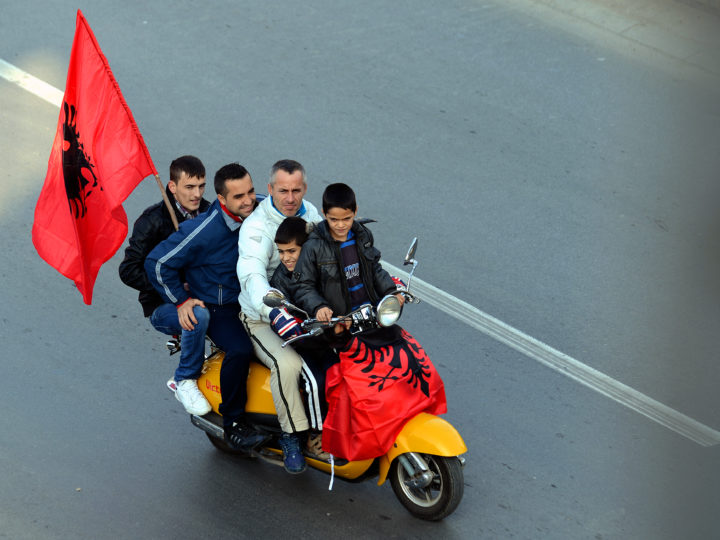epa03486081 Members of the ethnic Albanian minority in Macedonia wave Albanian flags while riding on a moped, decorated with an Albanian flag, as they celebrate the National Albanian Flag Day and the 100th anniversary of Albania's Independence, in Skopje, The Former Yugoslav Republic of Macedonia, 25 November 2012. The Macedonian Albanian community, which makes up for around 25 percent of the 2.1 million population of Macedonia, are the biggest ethnic minority in the country. The Albanian independence celebrations lasts for four days and ends with an all Albanian celebration in Valona, Albania on 28 November.  EPA/GEORGI LICOVSKI