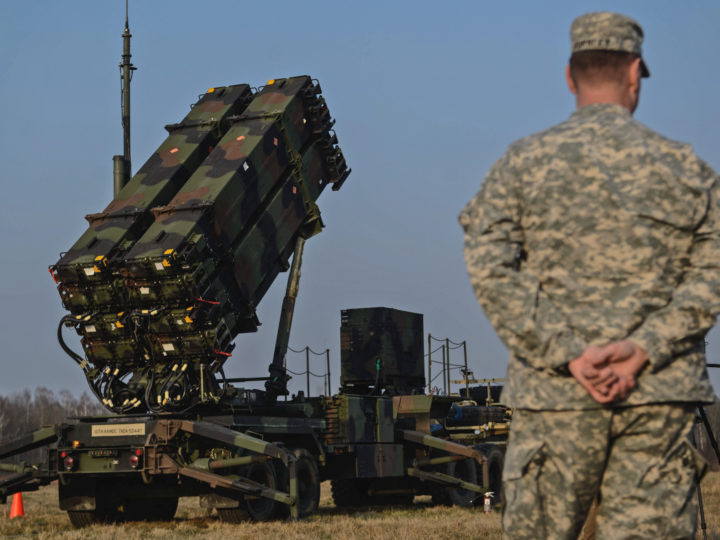 epa04673634 A US soldier stand behind a launcher vehicle of a US 'Patriot' air defence guided missile system battery positioned on a military training ground near Sochaczew, Poland, 21 March 2015, where soldiers of the Warsaw 3rd Air Defense Missile Brigade and US soldiers of  a 'Patriot' battery are exercising together within the Operation Atlantic Resolve. The exercise will involve some 100 US soldiers and 30 vehicles at a location on Polish territory, the US Department of Defense said in a media release on their website.  EPA/JAKUB KAMINSKI POLAND OUT