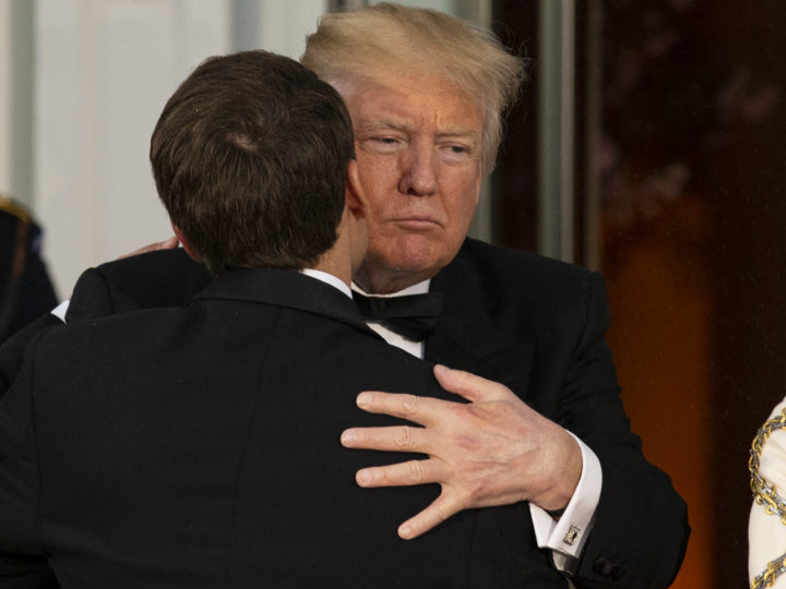 epa06690328 United States President Donald J. Trump (R) greets French President Emmanuel Macron (L) at the North Portico of the White House before a state dinner in Washington, DC, USA, 24 April 2018. President Macron is in DC for three days for a state visit and an address to a joint session of Congress on 25 April.  EPA-EFE/ALEX EDELMAN / POOL