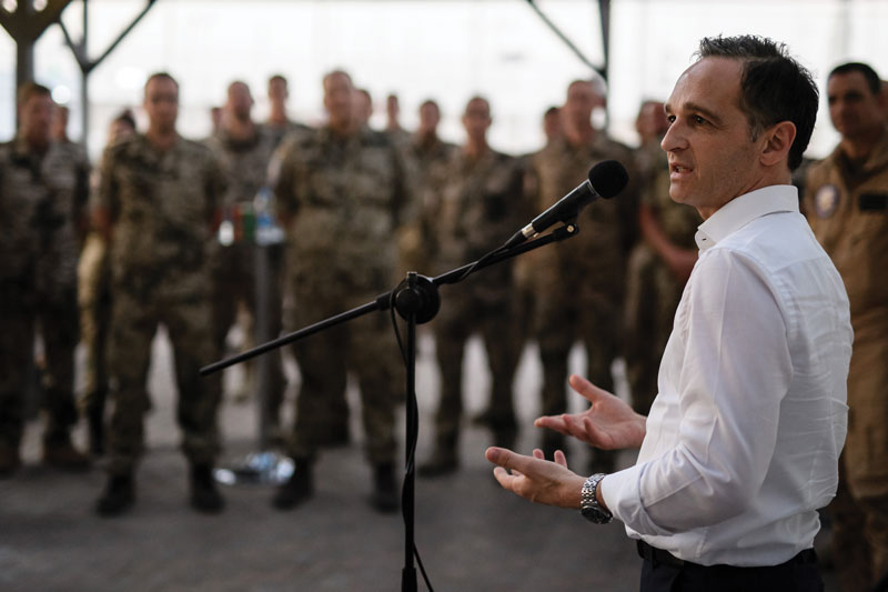 German Foreign Minister Heiko Maas speaks to members of German armed forces during a visit to an airbase, in Jordan April 5, 2018. EPA-EFE/CLEMENS BILAN