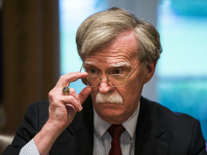 epa06658053 Newly appointed National Security Advisor John Bolton listens to US President Donald J. Trump speak to the media before a meeting with his military leadership in the Cabinet Room of the White House in Washington DC, USA, 09 April 2018.  Trump said he will decide in the next few days whether the US will respond militarily for the reported chemical weapons attack in Syria. Trump also spoke about the FBI raid of his personal attorney Michael Cohen's office.  EPA-EFE/JIM LO SCALZO