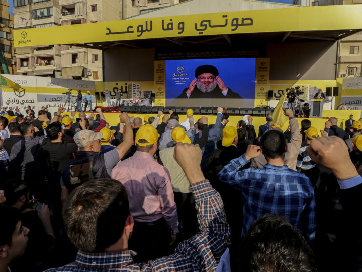 epa06667432 Lebanese supporters of Hezbollah listen to the speech of Hezbollah leader Sayyed Hassan Nasrallah on a giant screen, during a general elections Festival for the candidates of Beirut in southern suburb of Beirut, Lebanon, 13 April 2018. Nasrallah spoke of the sectarian mobilization by the currents of the candidates for the elections in order to gain supporters, and said that they are exposing the country to a slide into a major dispute that harms the homeland. Nasrallah spoke also on how US's government an its allies are dealing with the Syrian conflict.  EPA-EFE/Nabil Mounzer