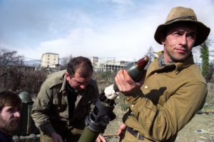 An Abkhaz soldier loads a mortar ready to shell the Georgian positions near Eshery, Abkhazia, Georgia on February 23, 1993. EPA/OLEG NIKISHIN