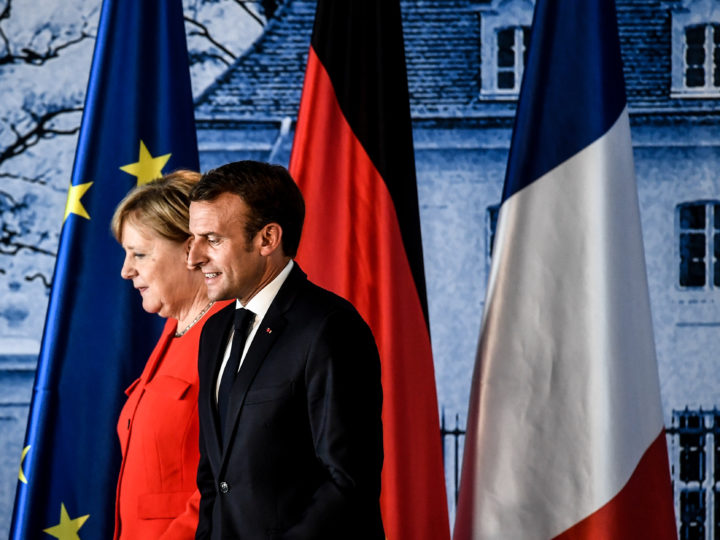 epa06821678 German Chancellor Angela Merkel (L) and French President Emmanuel Macron after a press conference during the German-French Minister Meeting at German government's guest house Meseberg Palace in Meseberg, near Berlin, Germany, 19 June 2018. German and French ministers meet for a one day meeting to discuss bilateral topics, including Foreign, Defence and Security politics.  EPA-EFE/FILIP SINGER