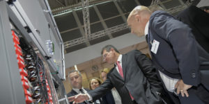 Maros Sefcovic  (C) Vice President of the European Commission for Energy Union, talks Leo Botti (L) ABB to during his visit at the INTERSOLAR in Munich, Germany on June 21 2018.