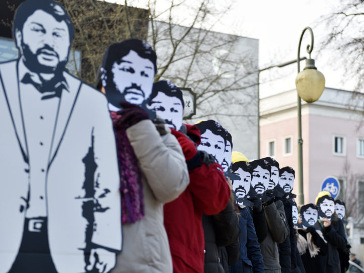 epa06502154 Protester with masks of Taner Kilic stand in a line during a protest of Amnesty International for the immediate release of Taner Kilic, the president of the Turkish section of Amnesty International, outside the Turkish embassy in Berlin, Germany, 07 February 2018. A court in Turkey ordered to release Taner Kilic who is charged to be a member of the Guelen movement, but 24h later the court rescinded the decision.  EPA-EFE/MARKUS HEINE